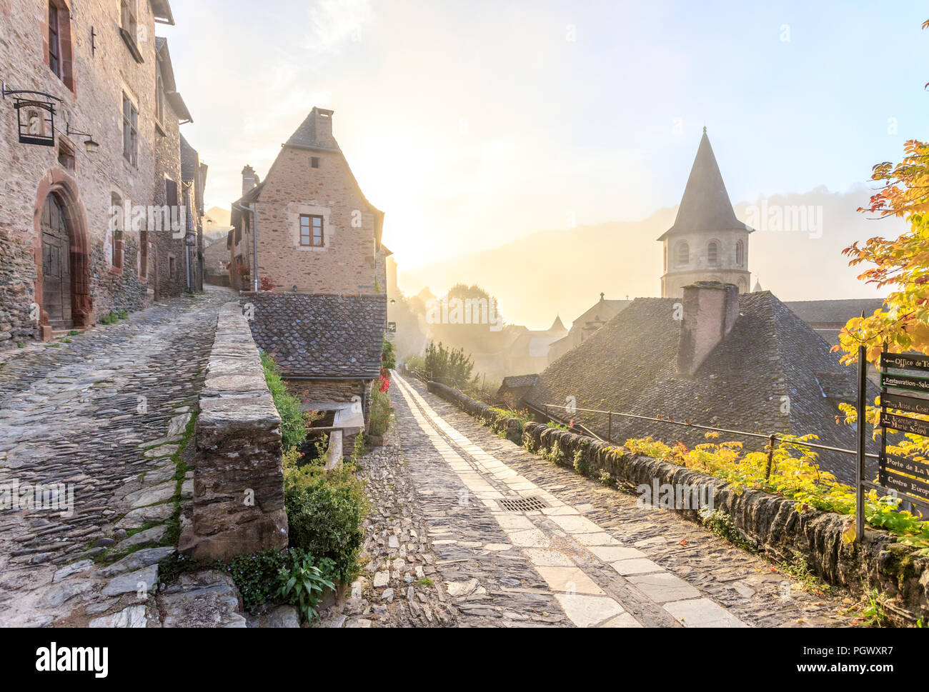 France, Aveyron, Conques, labelled Les Plus Beaux Villages de France (The Most Beautiful Villages of France), stop on El Camino de Santiago, alleyway  - Stock Image