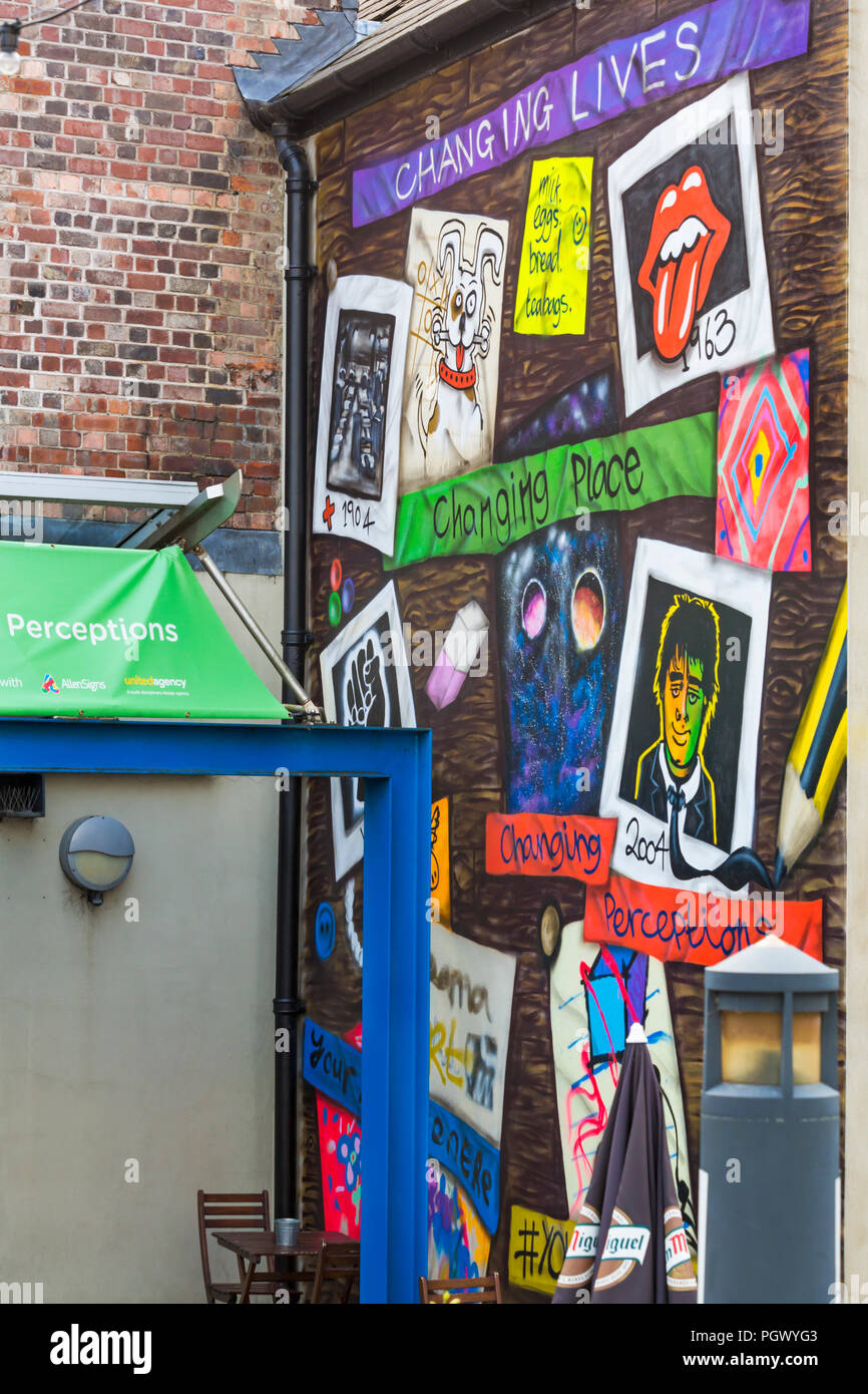 Changing Lives, Changing Place, Changing Perceptions on wall of Lincoln Drill Hall at Free School Lane, Broadgate, Lincoln in August - Stock Image