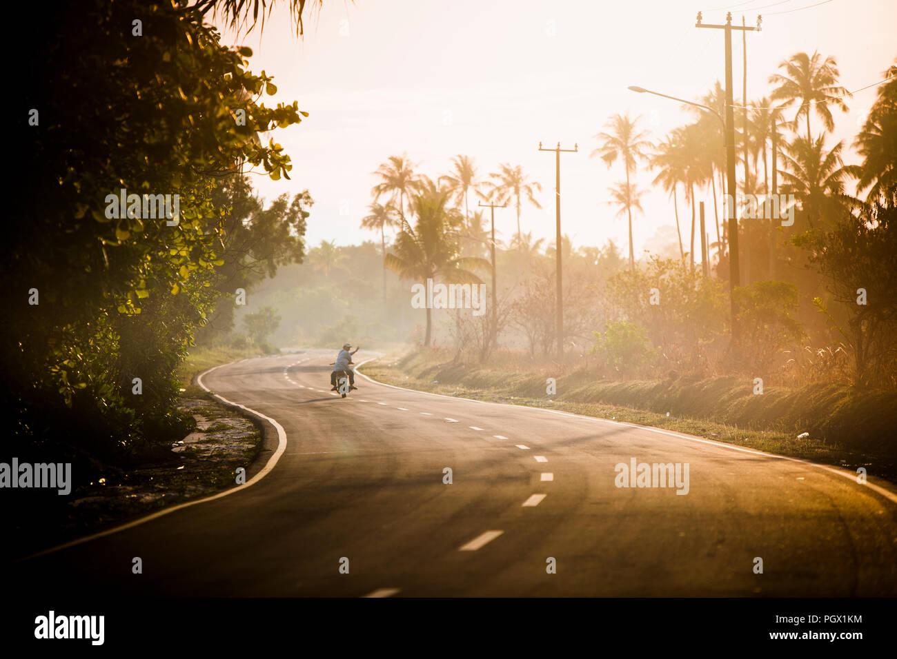 Sunrise commute on Belitung Island, Indonesia. - Stock Image