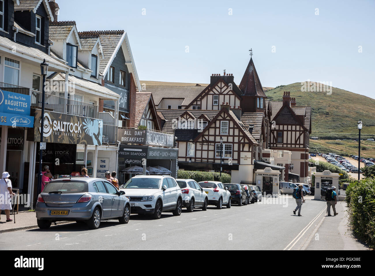 Woolacombe shop fronts and hotel near the beach front on a bright sunny day in the summertime in Woolacombe, North devon, England - Stock Image