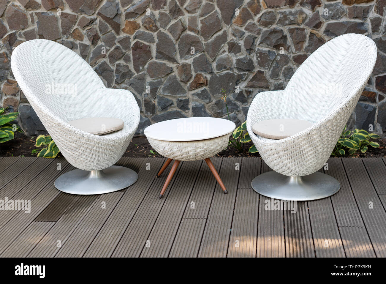 Modern white armchairs and table, modern garden furniture ...