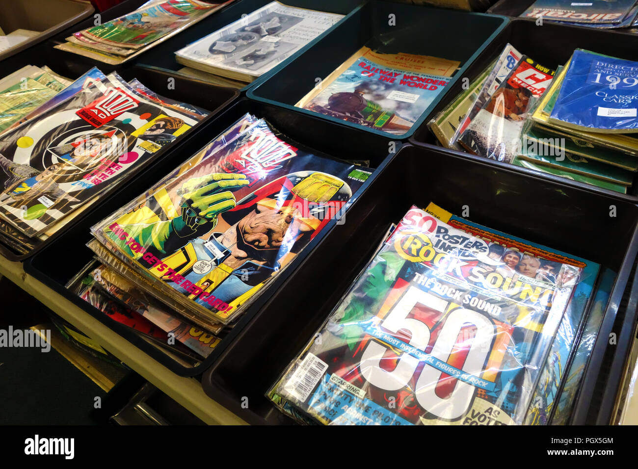 Comic magazine and Bric-à-brac on display an English Antiques centre - Stock Image