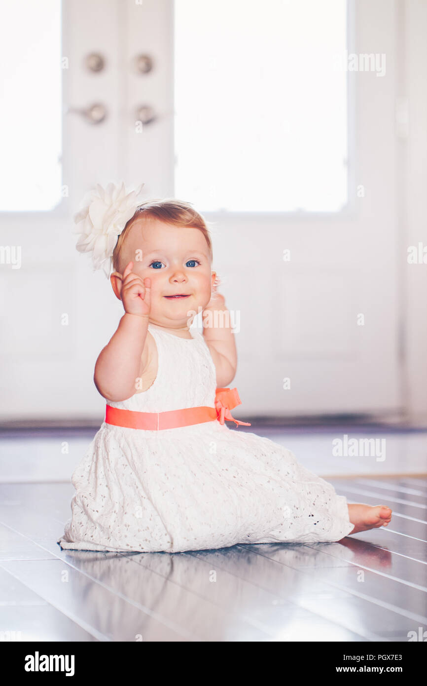 136be8c52 Portrait of cute adorable blonde Caucasian smiling baby child girl ...