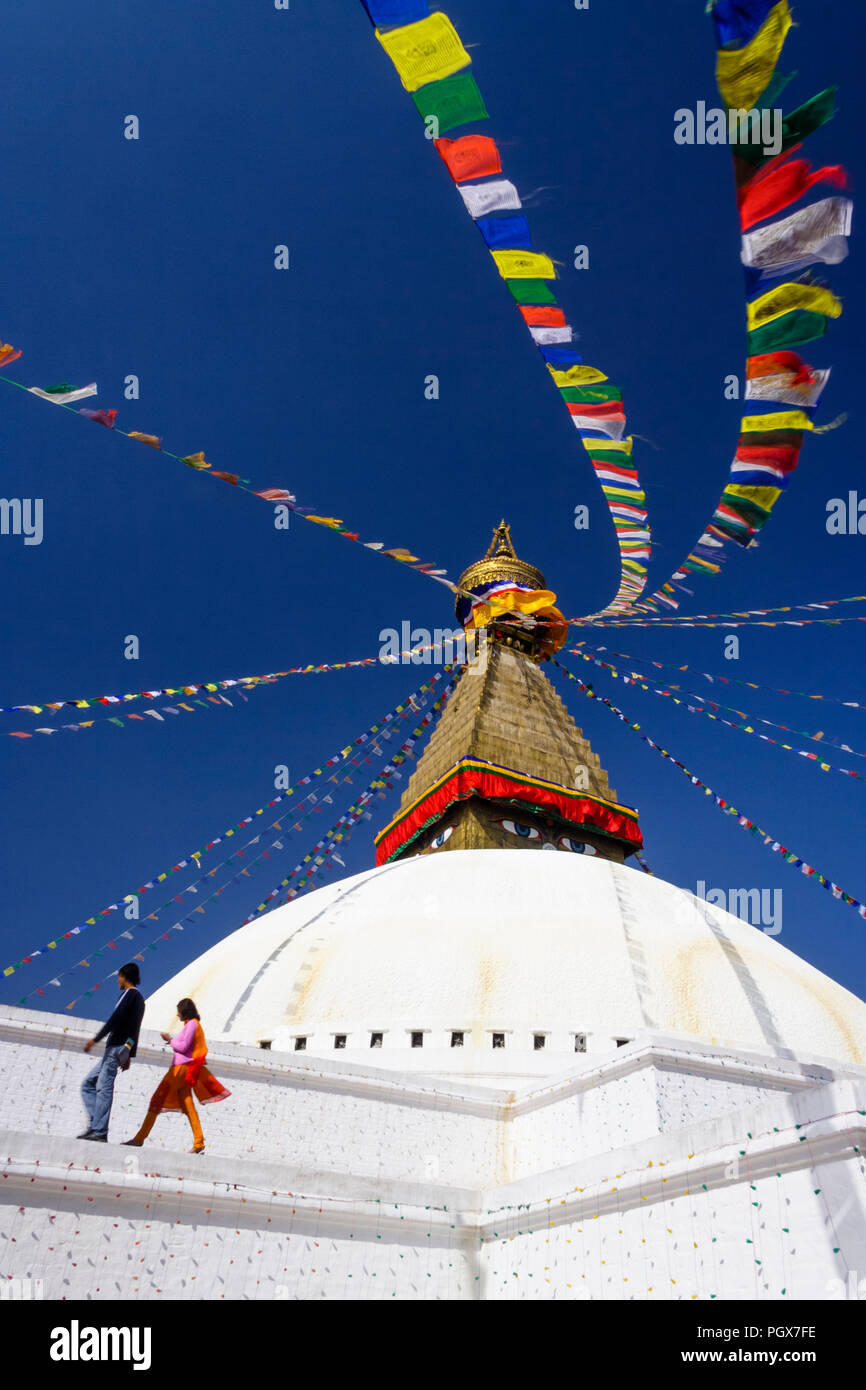 Bodhnath , Kathmandu, Bagmati, Nepal : People walk around the Great stupa of Bodhnath, the largest in Asia and one of the larger in the world. - Stock Image