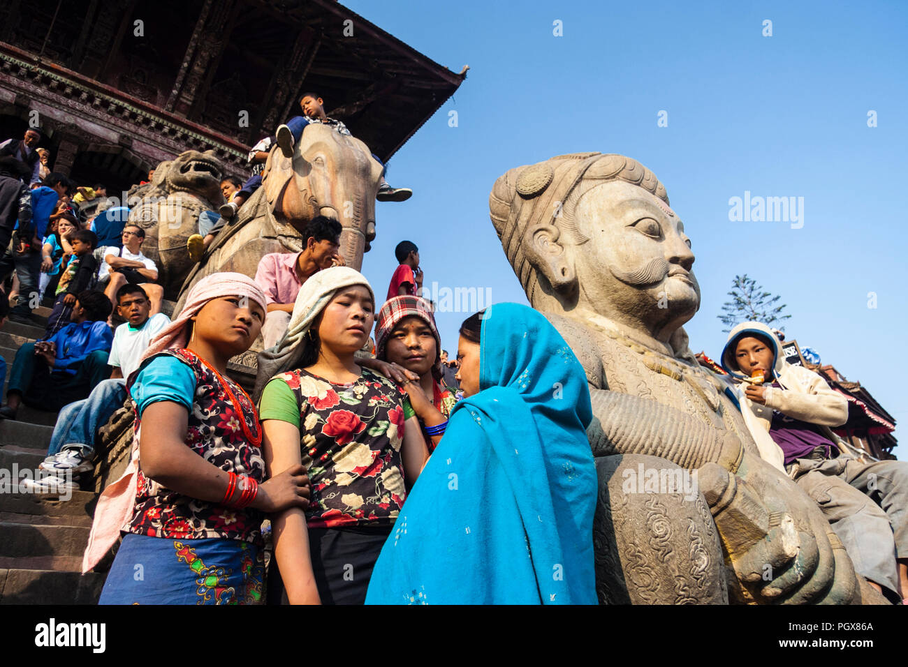 Bhaktapur, Kathmandu Valley, Bagmati, Nepal : Onlookers gather at the steps of the Nyatapola temple at Taumadhi tole square before the inauguration of - Stock Image