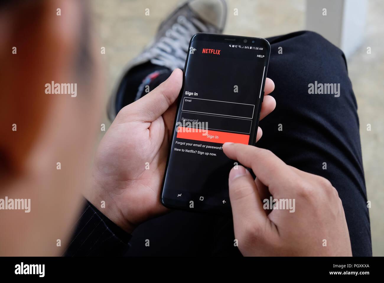 CHIANGMAI,THAILAND - August 22,2018: A Man opening Netflix in