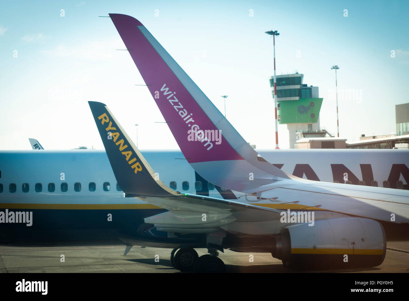 Ryanair and Wizzair winglets are seen on Boeing 737 airliners at Bergamo airport in Italy. - Stock Image