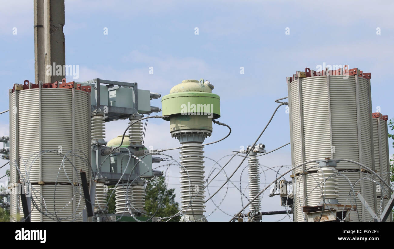 Aerial view Power plant, transformation station, cables and wires. Electrical power transformer in high voltage substation. High voltage electric power substation. - Stock Image