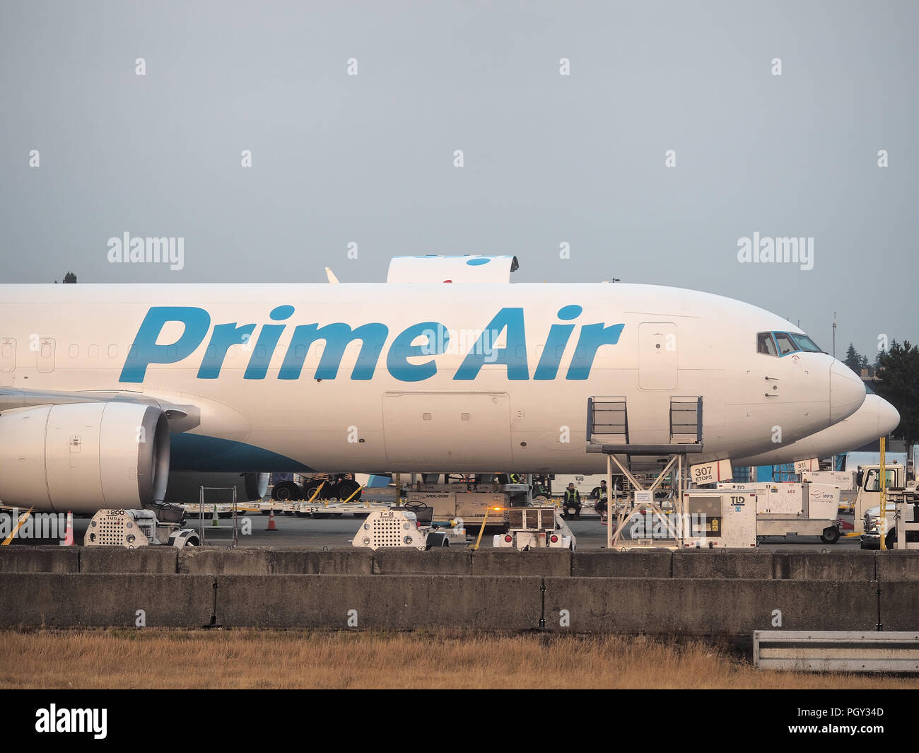 Amazon Prime Air cargo aircraft loading at Seattle–Tacoma International Airport in August 2018 - Stock Image