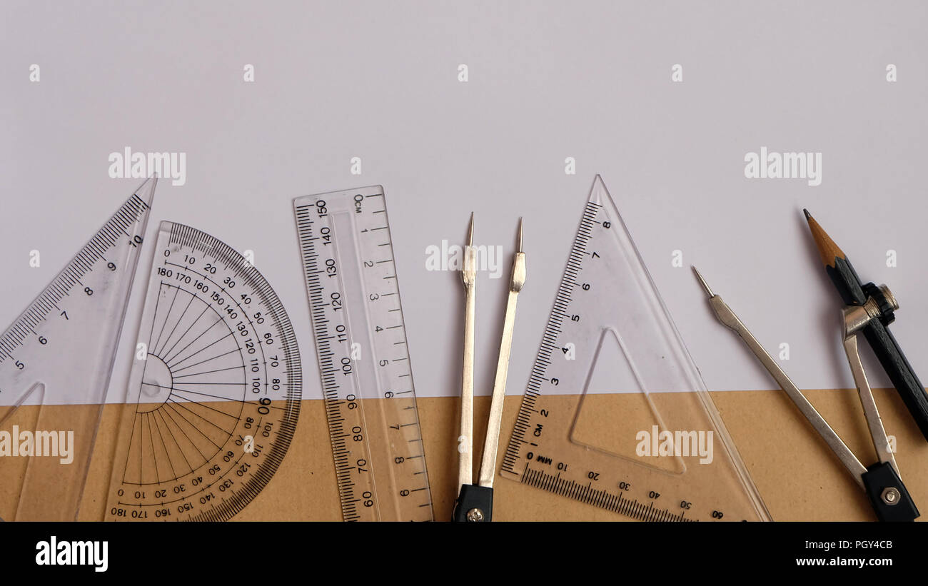 Flat lay of protractor compass set rulers - Stock Image
