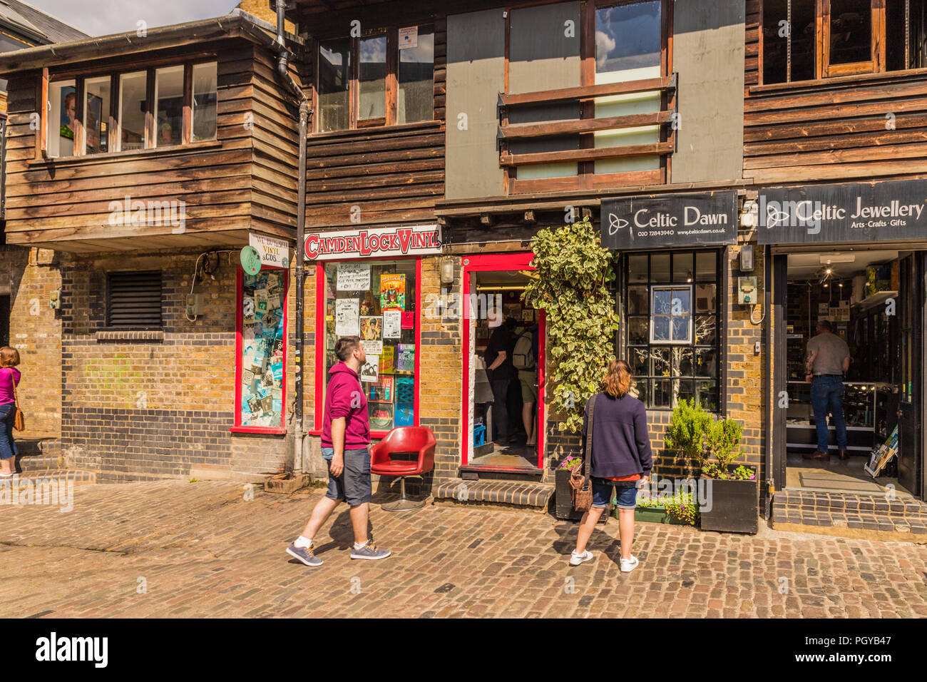 A typical view in Camden Market london - Stock Image
