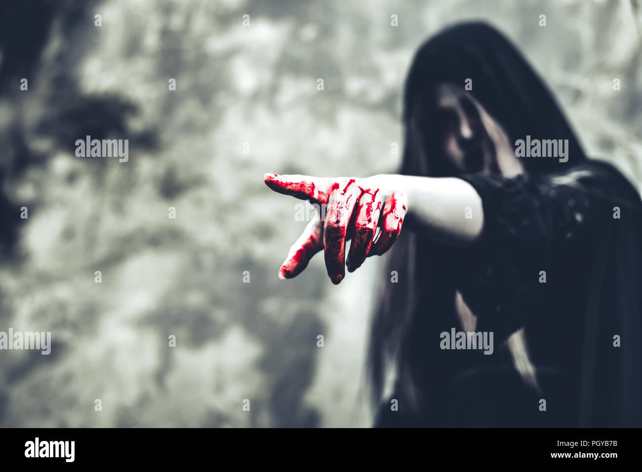 Close up of bloody ghost hand pointing to the front. Horror and ghost concept. Halloween and scary movie theme. Abandoned house theme - Stock Image