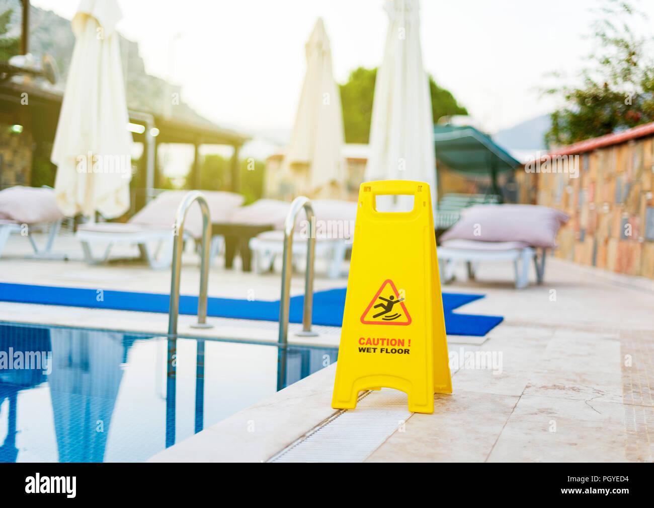 Slippery floor sign - Stock Image