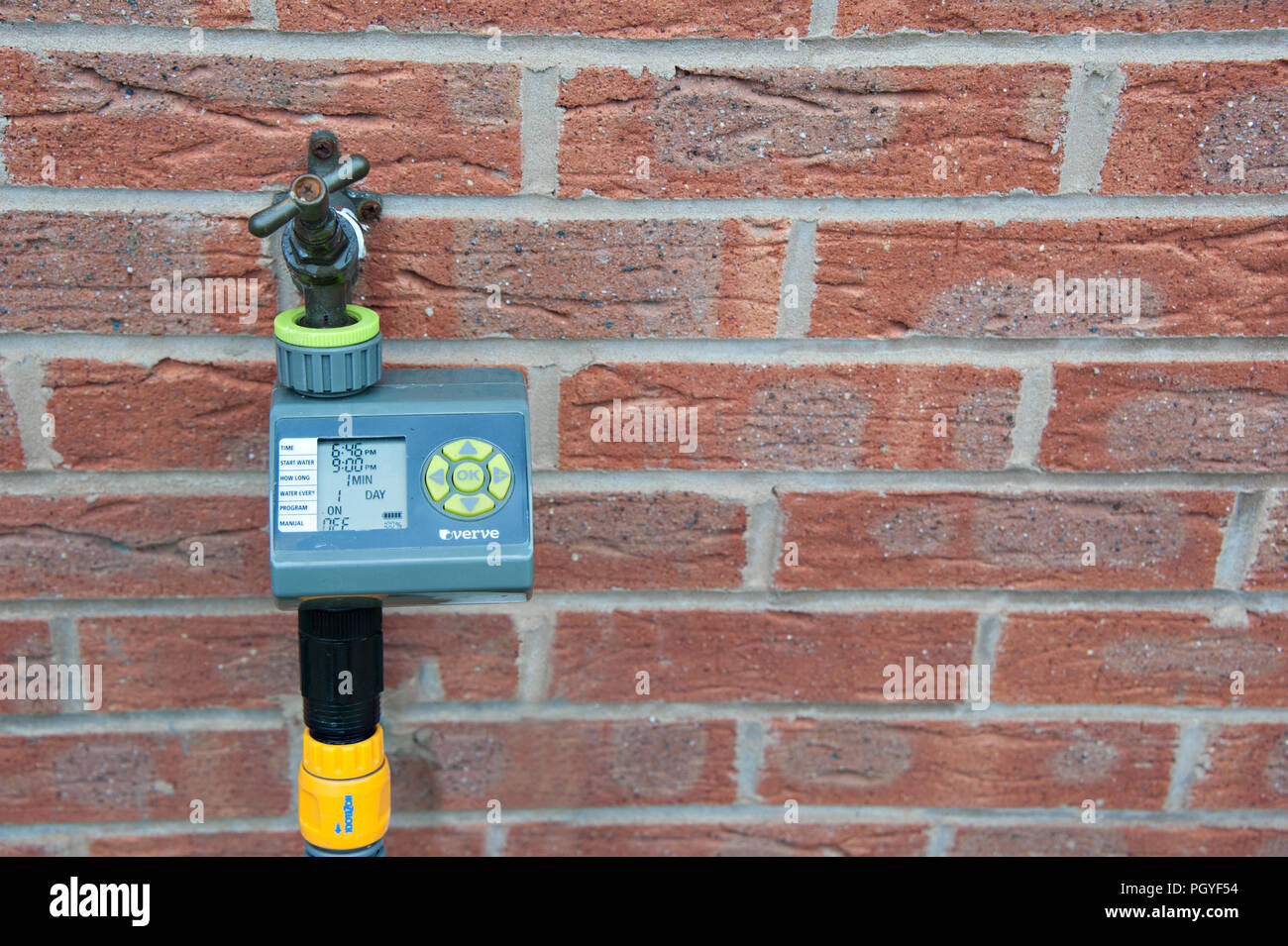 verve programmable water timer fixed to a brick wall Stock Photo