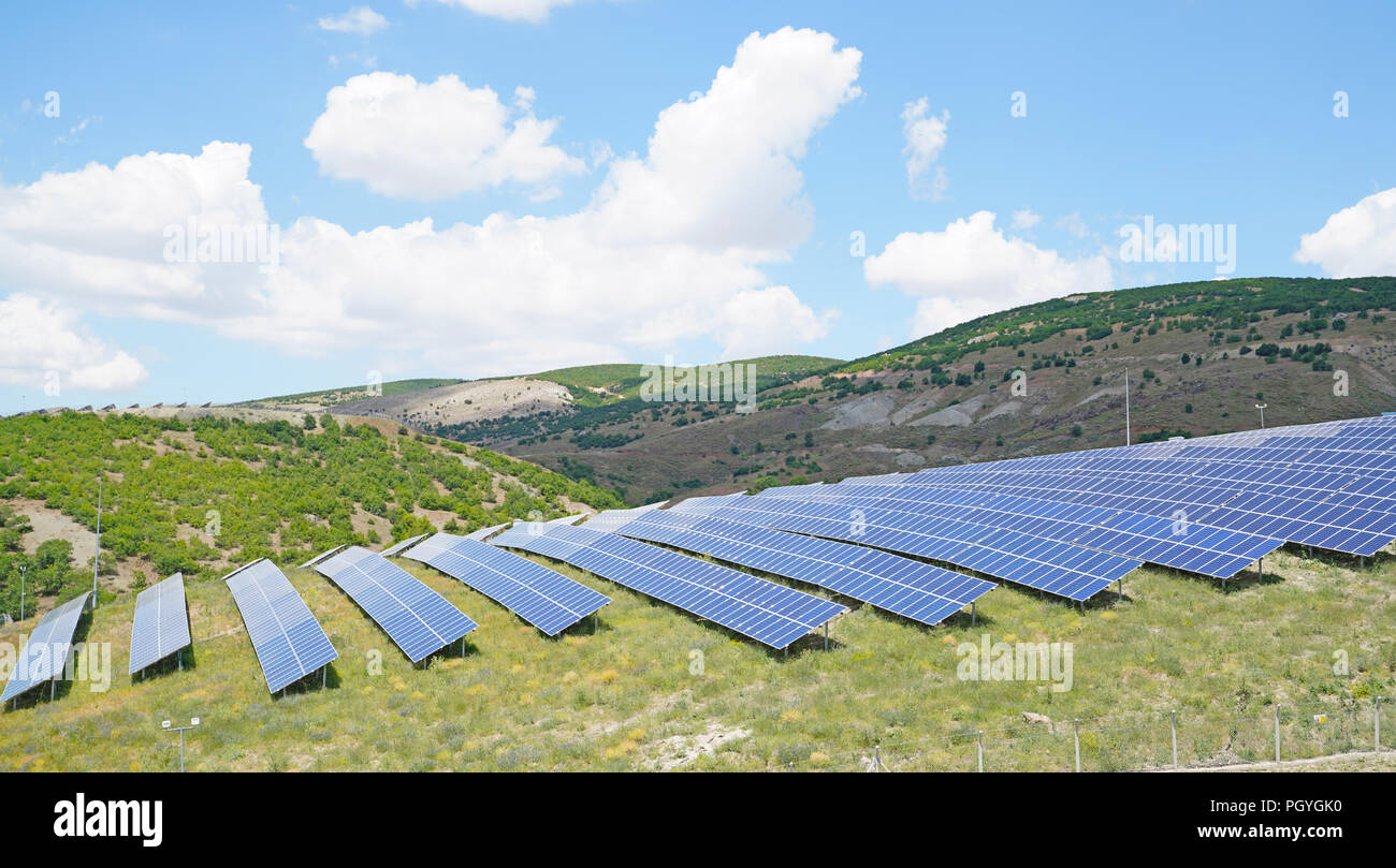 Solar park with blue cells on a green field, Sivas, Turkey - Stock Image
