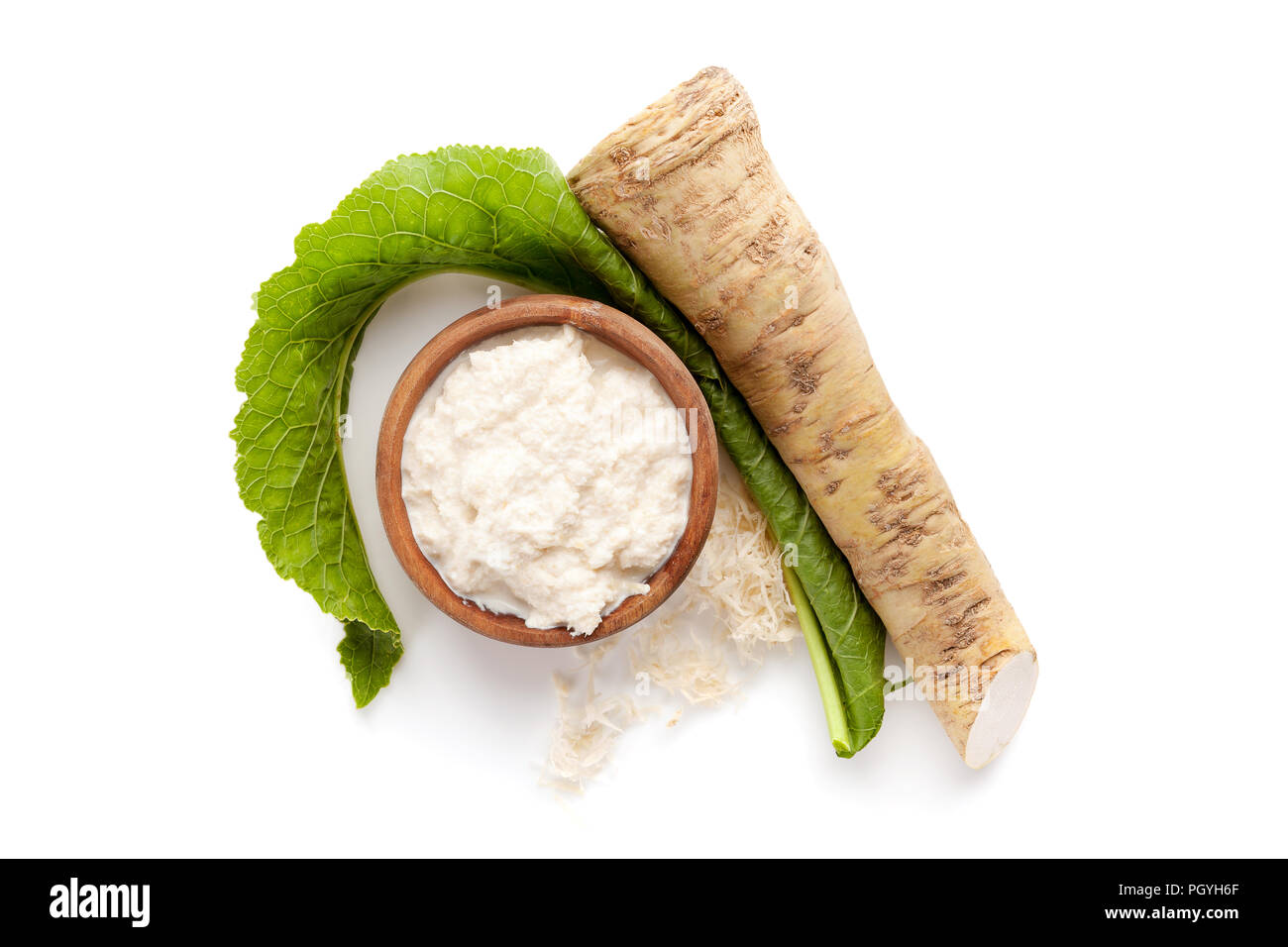 Horseradish in wooden bowl isolated on white background from above. - Stock Image