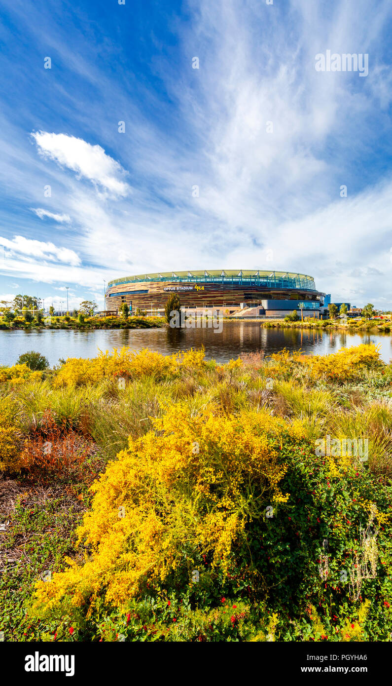 Optus Stadium and Stadium Park with native plants growing beside a lake - Stock Image