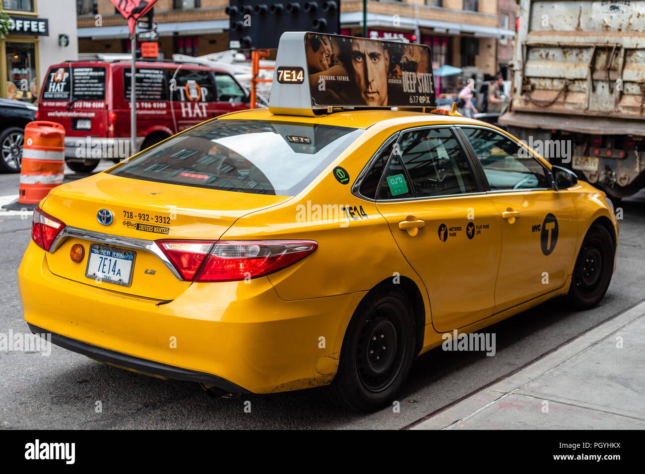 New York City, USA - June 22, 2018: Yellow taxi cab parked in the street bridge in Manhattan - Stock Image