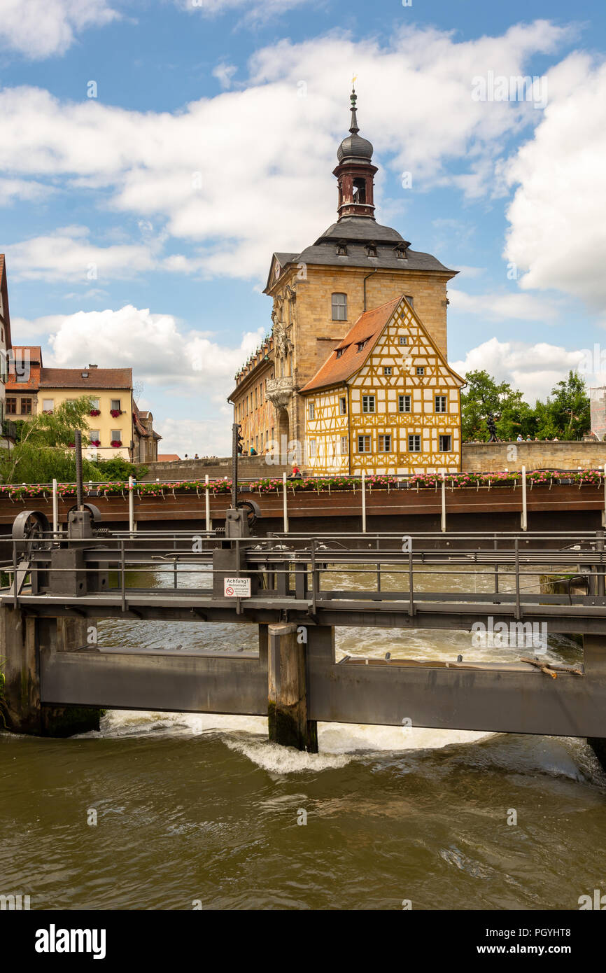 BAMBERG, GERMANY - JUNE 19: Tourists at the historic town hall in Bamberg, Germany on June 19, 2018. The famous town hall was built in the 14th centur - Stock Image