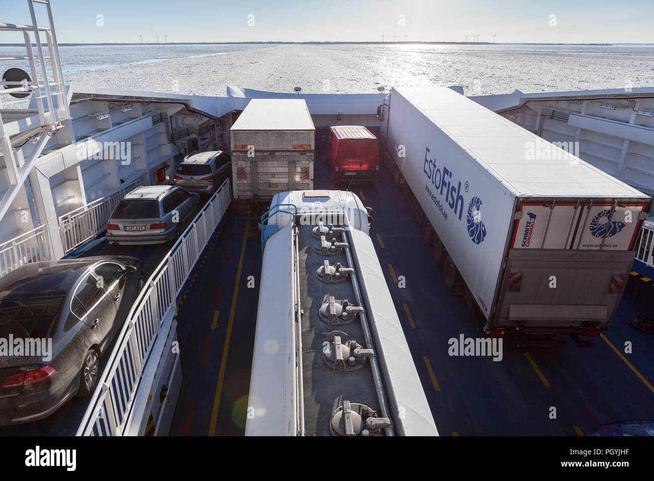 9bf35445167 ESTONIA- CIRCA MAR, 2018: Semitrailer trucks are parked on deck of ferry.