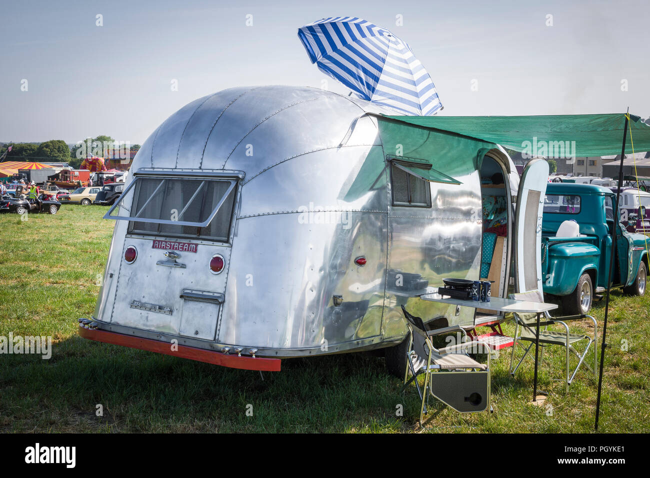 An old American Airstream streamlined caravan at Heddington Country Fair and Steam show in Wiltshire England UK - Stock Image