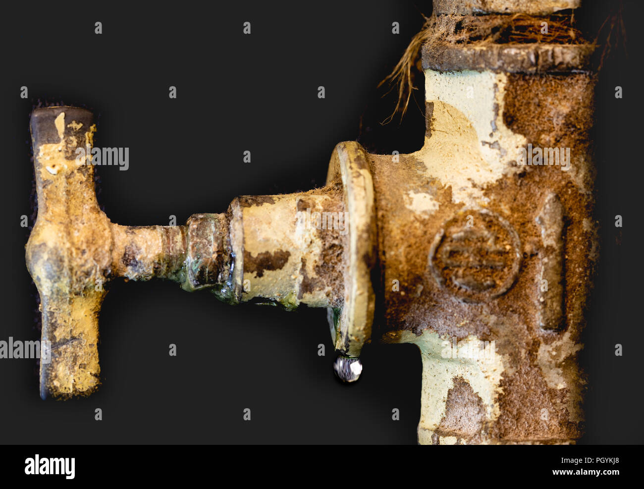Leaking valve, scale, fur on the rusty pipe.  Leakage. - Stock Image