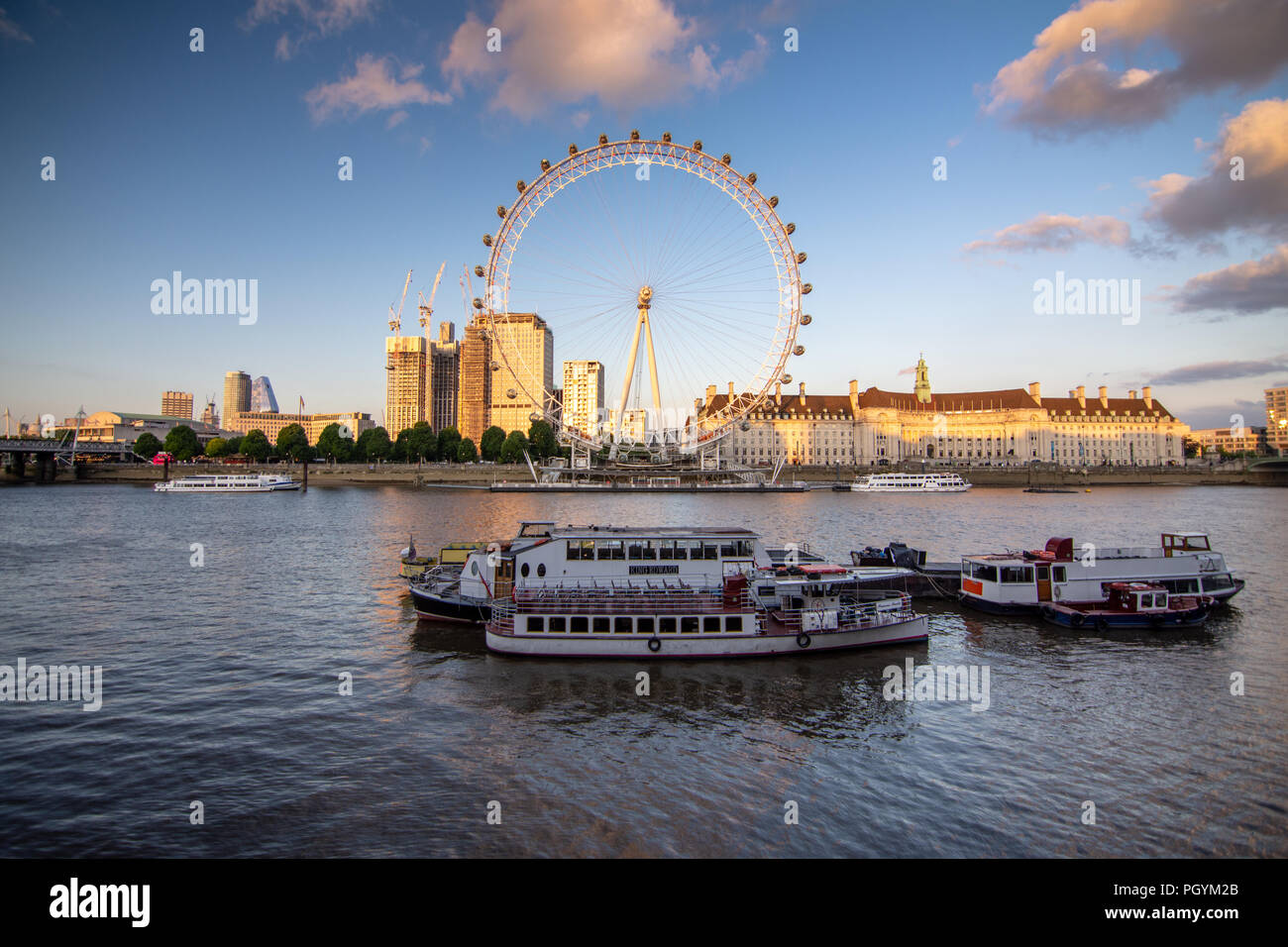 London, England, UK - June 12, 2018: New skyscrapers are under construction at the Shell Centre behind the London Eye observation wheel on the South B - Stock Image