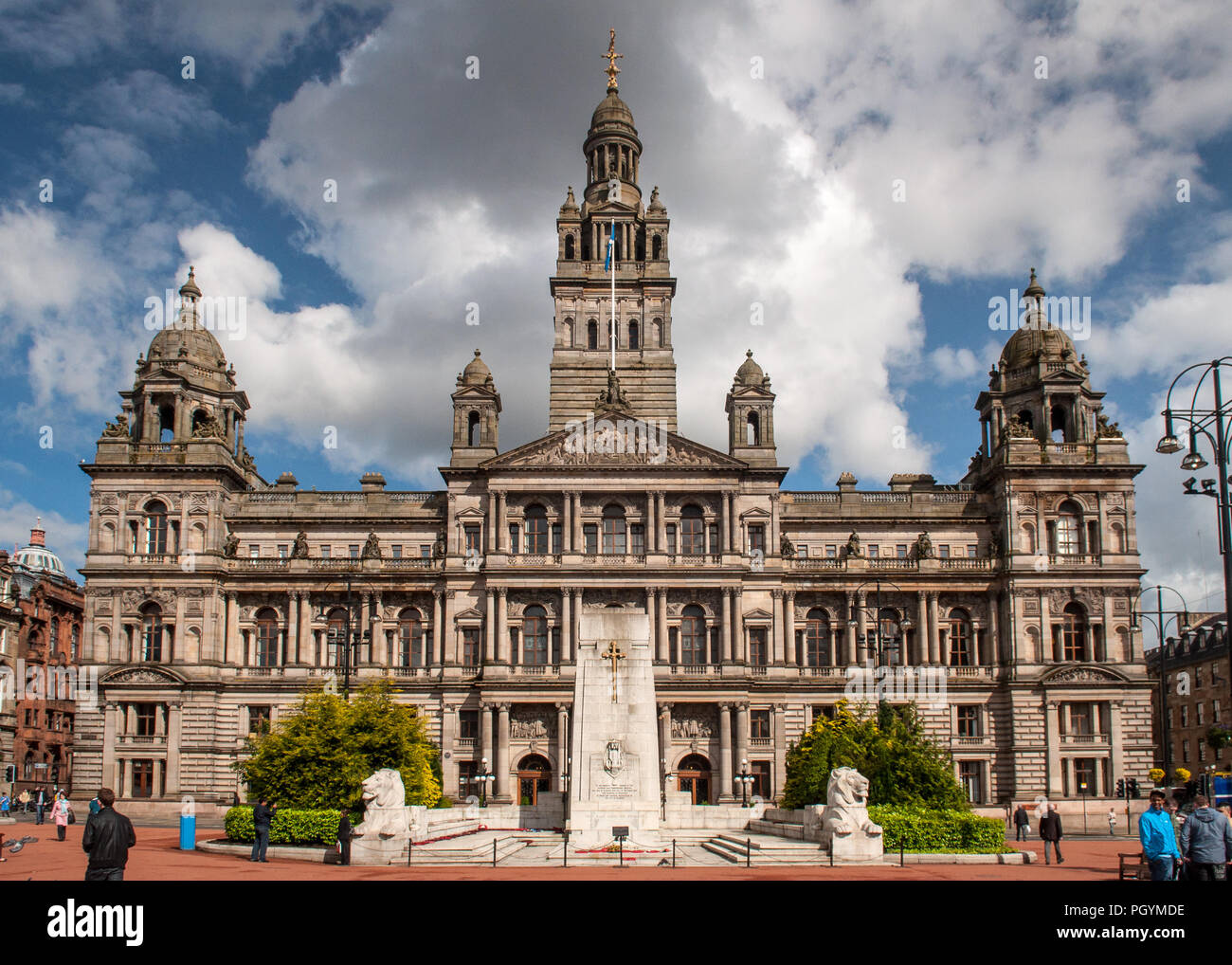 Glasgow, Scotland, UK - May 21, 2011: Sun shines on the Beaux-Arts facade of Glasgow City Chambers in George Square. Stock Photo