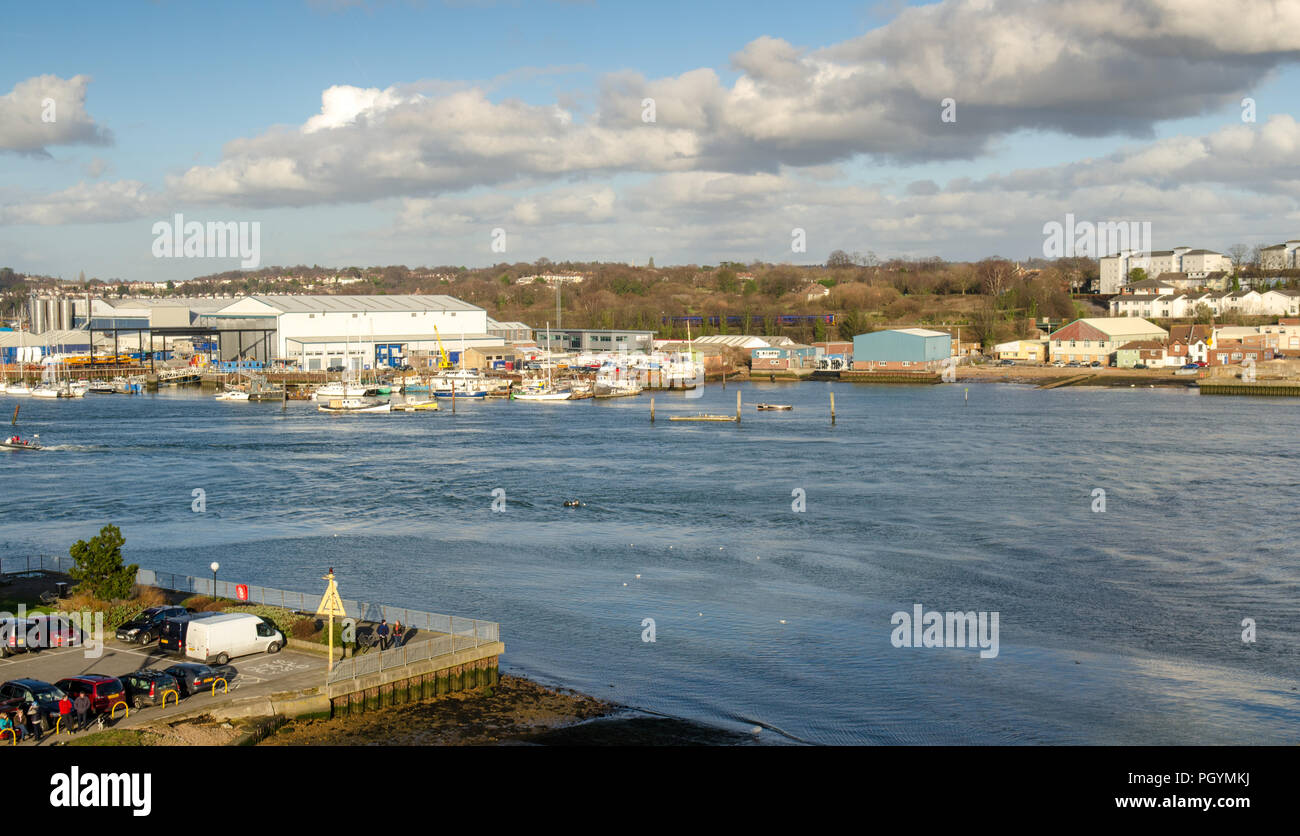 Southampton, England, UK - February 16, 2014: A First Great Western Railway train runs alongside the River Itchen in the suburbs of Southampton. - Stock Image