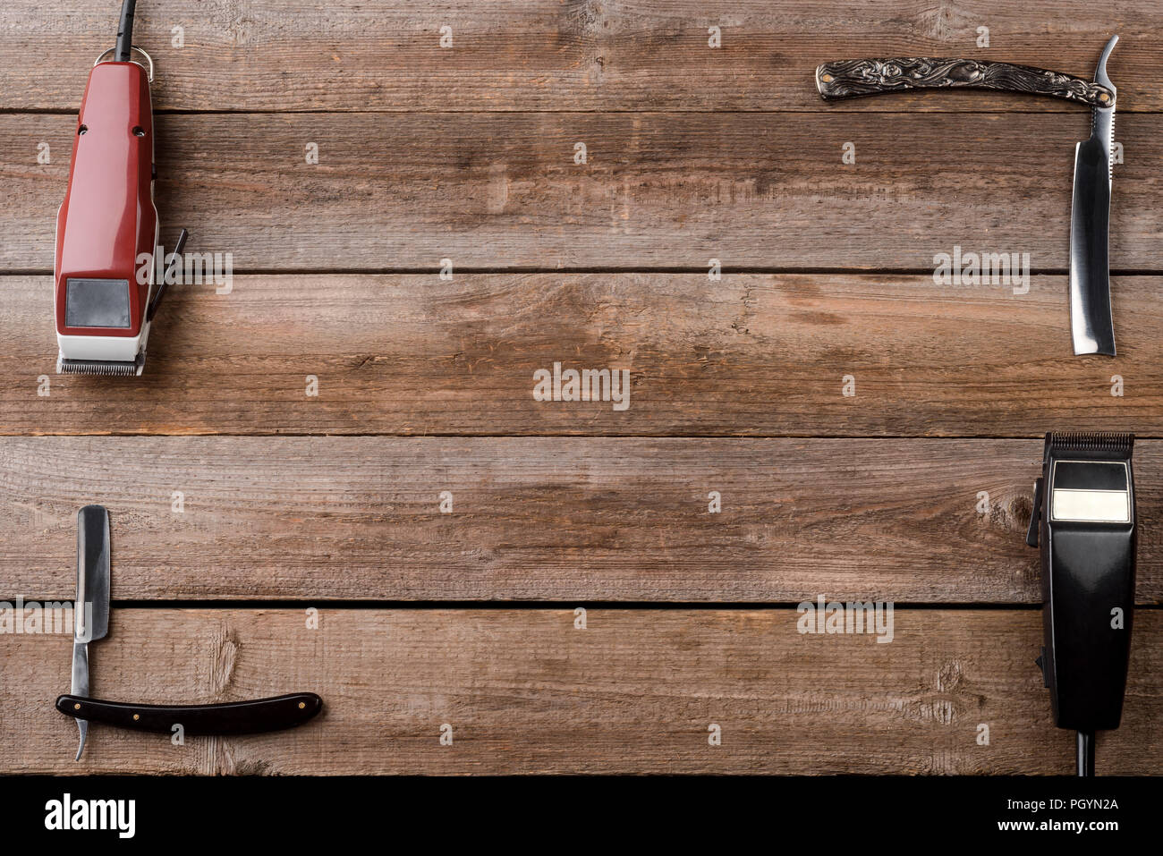 Electric clippers on wooden background - Stock Image