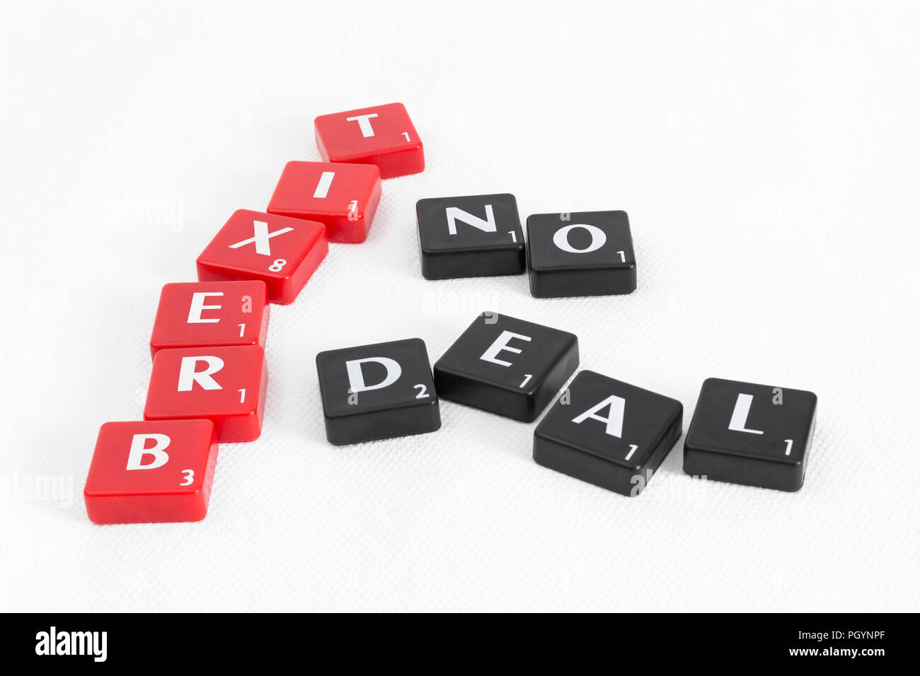 BREXIT / Brexit negotiations end game - deal or no deal? Letter tiles on textured neutral backdrop. EU UK relationship concept. Stock Photo