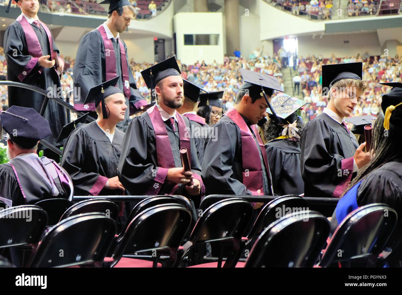 Students at an American university graduation. - Stock Image