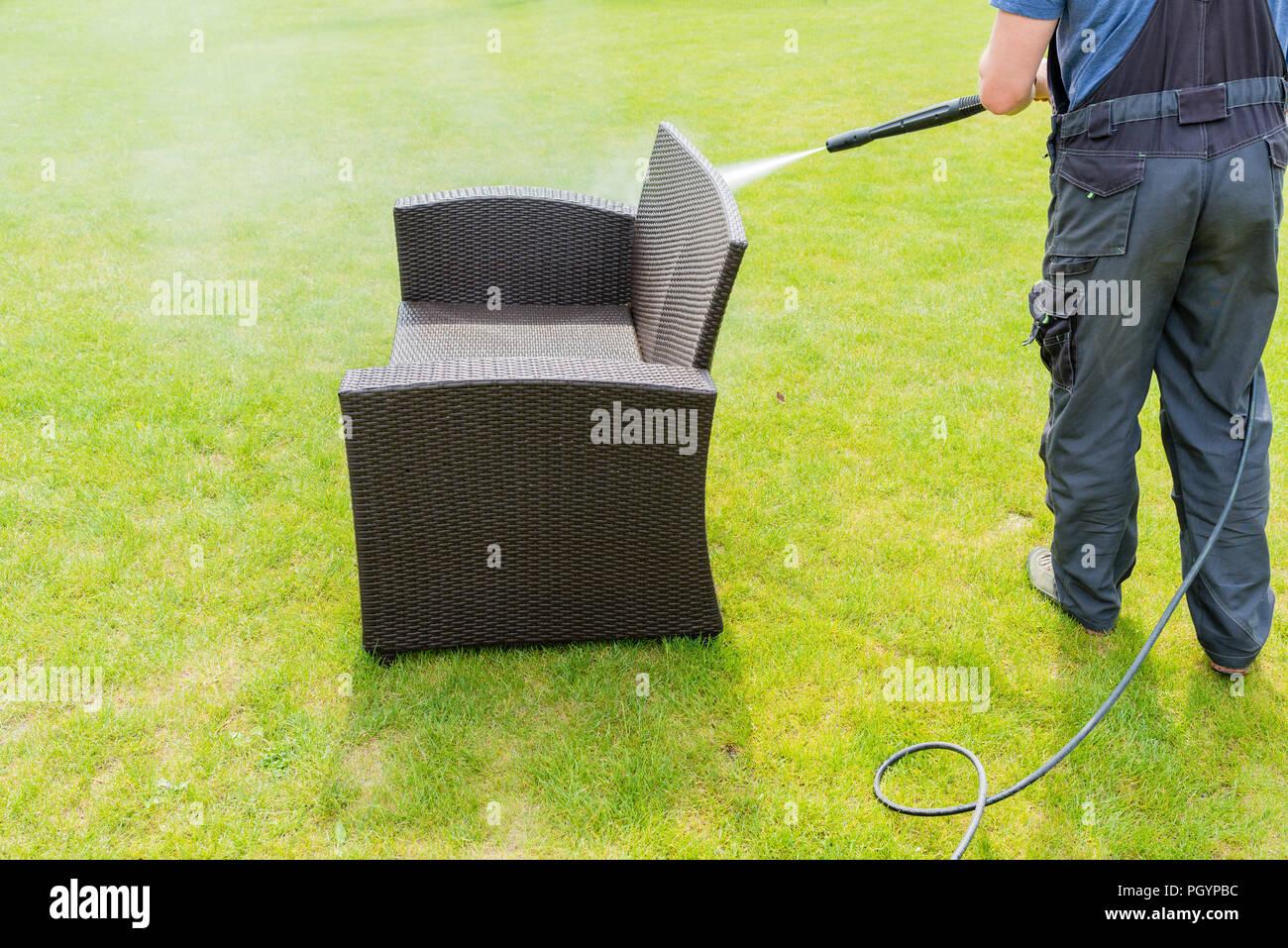 power washing garden furniture - made of rattan Stock Photo