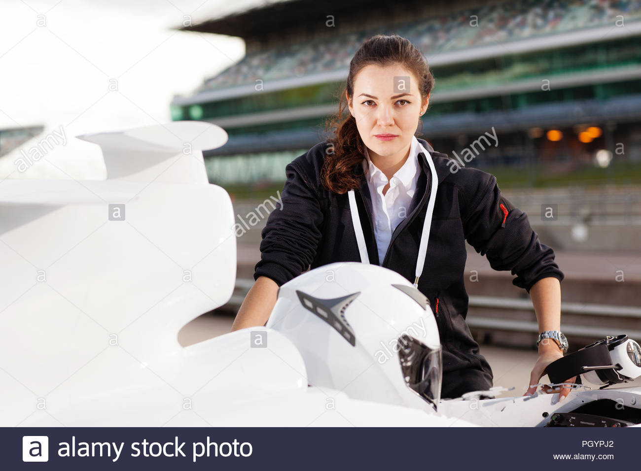 PR manager and Driver in Pits - Stock Image