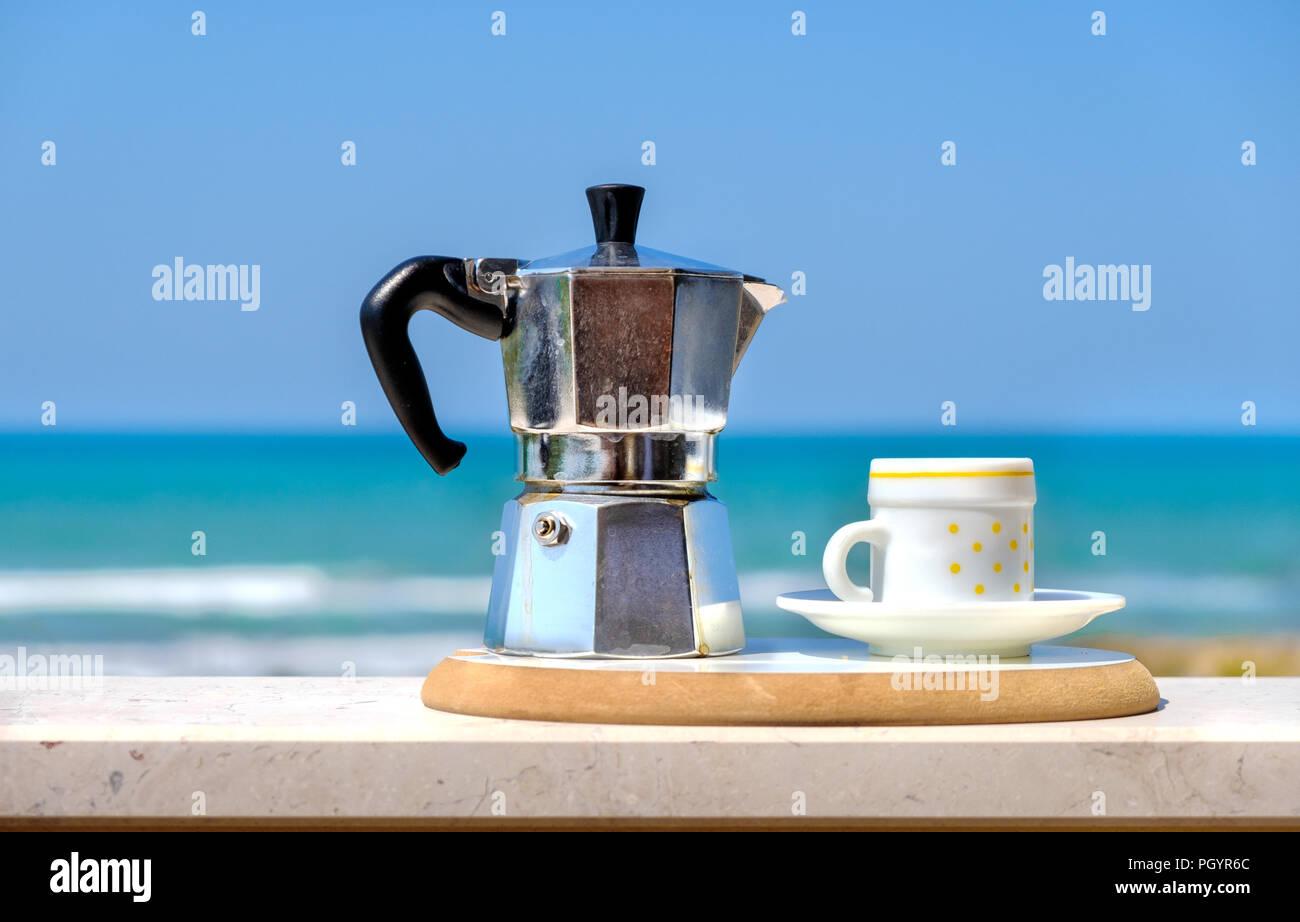 moka pot coffee maker sea background italian breakfast - Stock Image