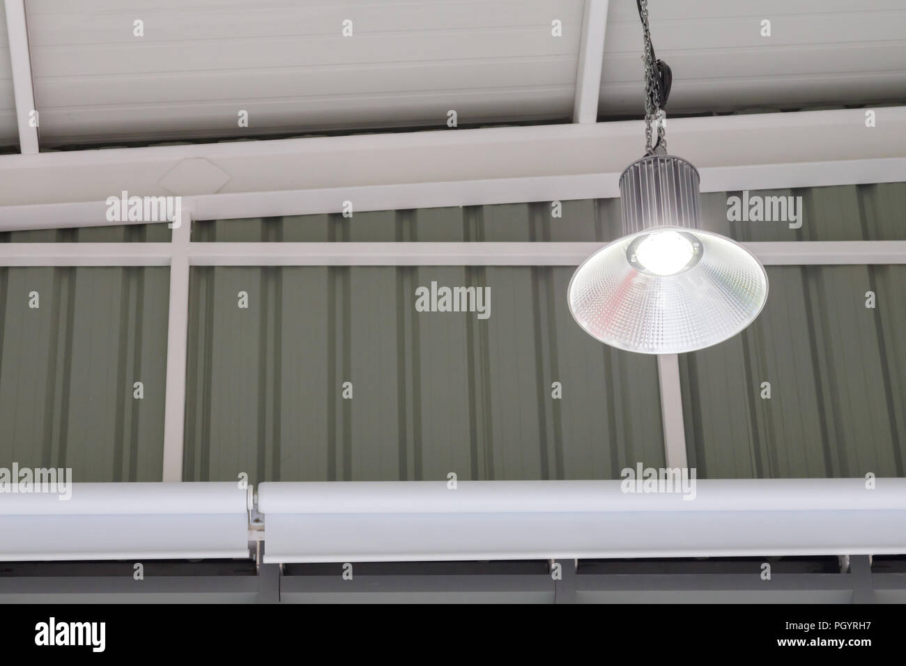 Led Light Bulb In The Industrial Lamp Is Bright On The Ceiling Of The New Warehouse With Copy Space High Bay Lighting Stock Photo Alamy