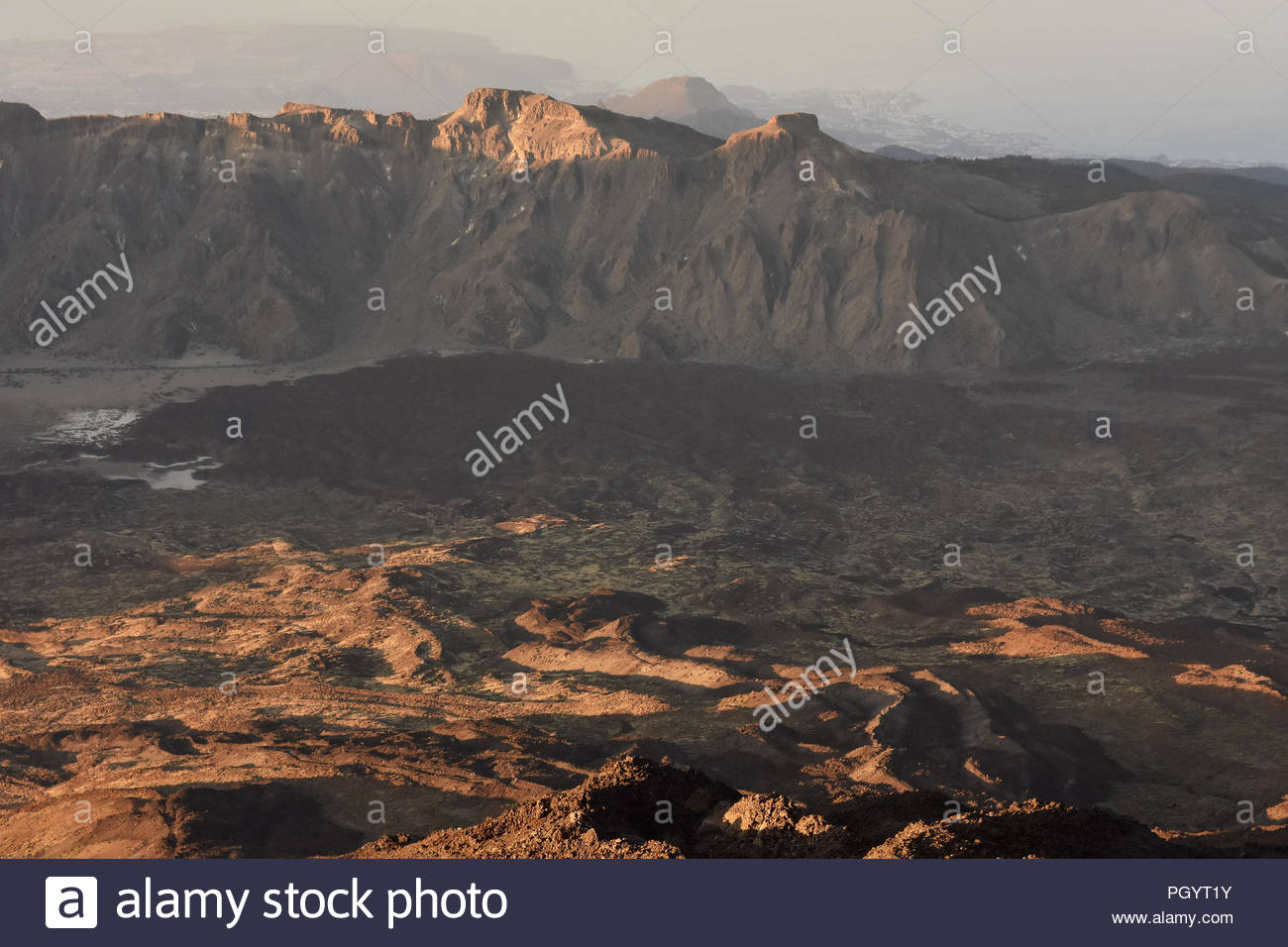 Llano de Ucanca - valley with lava fields and volcanic mountains of Teide National Park Tenerife Canary Islands Spain. Elevated view from Mount Teide. - Stock Image