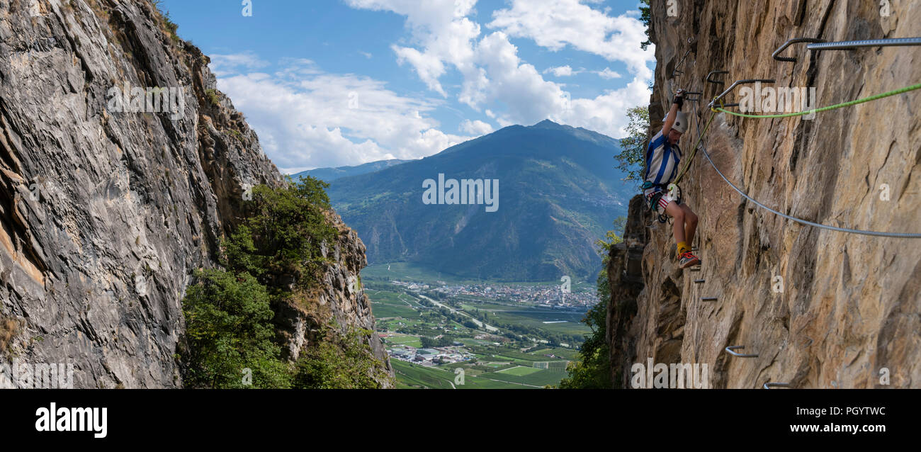A young boy on an exposed Via Ferrata in Switzerland Stock Photo