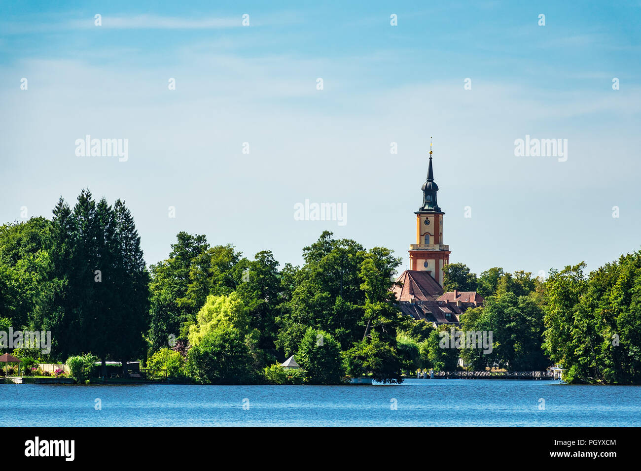 Church on a lake in Templin, Germany. - Stock Image