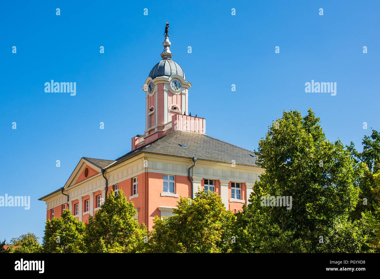 Historical city hall with trees in Templin, Germany. - Stock Image