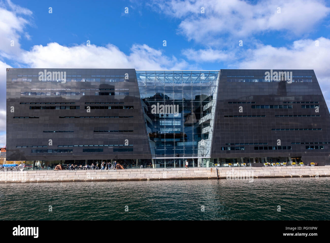 Reflection in the facade of the Royal Danish Library, The Black Diamond library, Designed by architects Schmidt Hammer Lassen, Copenhagen, Denmark. Stock Photo
