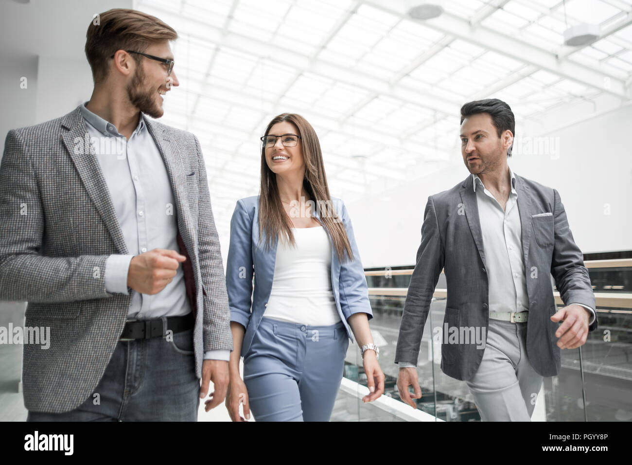 group of managers talking in the business cente - Stock Image