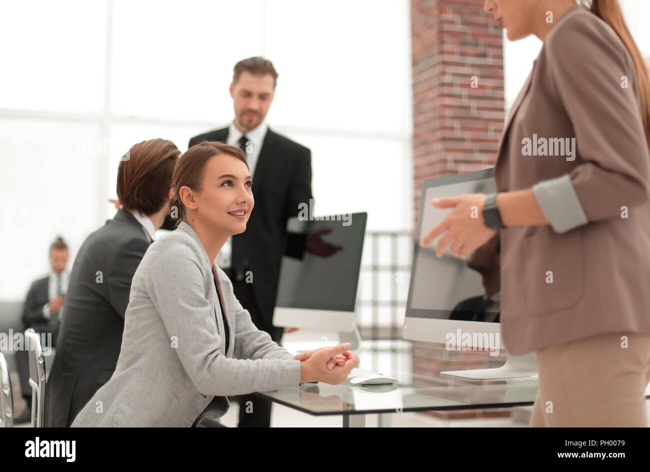 young Manager talking to the client. - Stock Image