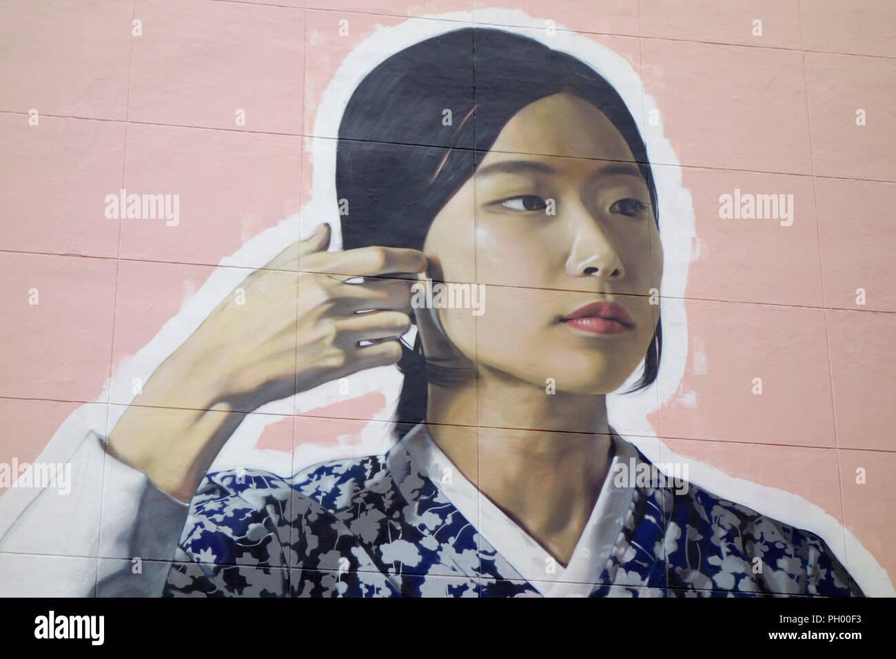 Graffiti Artworks in Seoul depicting a Korean woman in traditional Korean Hanbok clothing. Painted as part of POW! WOW! Korea 2017. - Stock Image