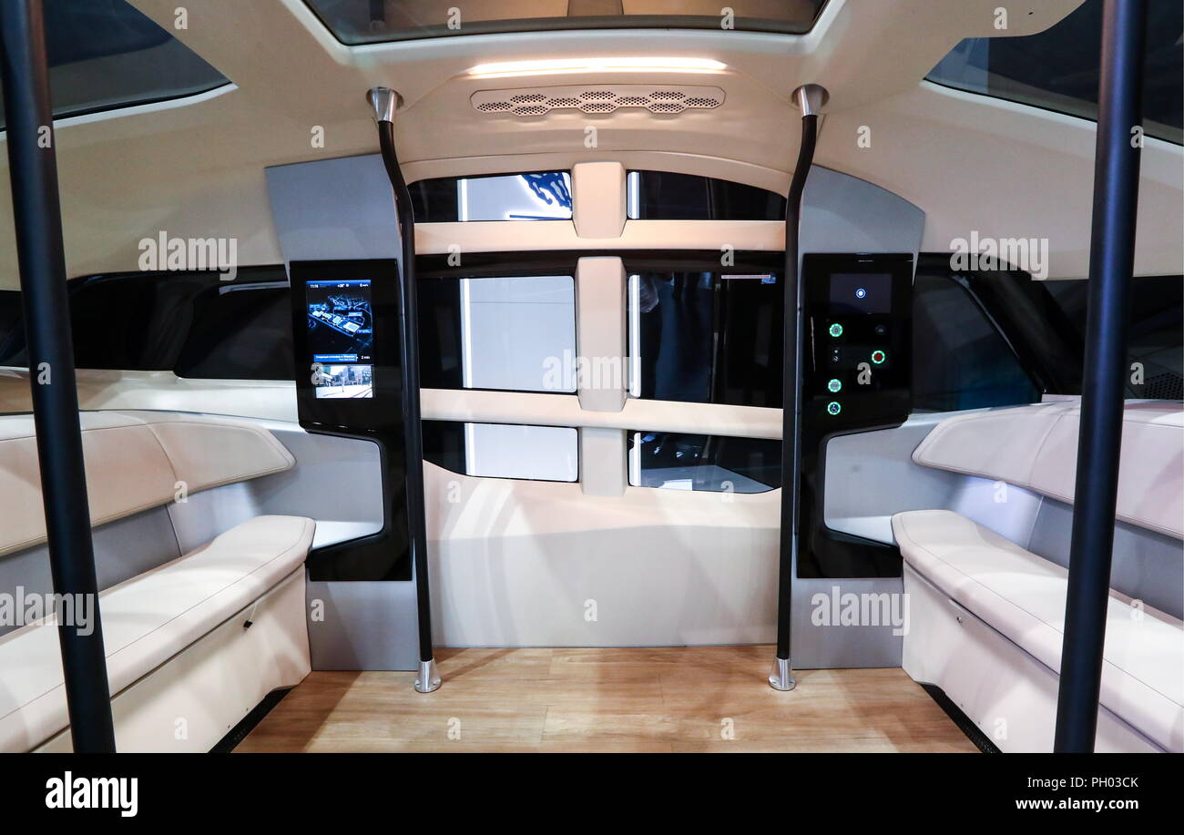 MOSCOW REGION, RUSSIA - AUGUST 29, 2018: The interiors of a KAMAZ-1221 SHATL autonomous electric bus at the 2018 Moscow International Motor Show at the Crocus Expo exhibition center. Stanislav Krasilnikov/TASS - Stock Image