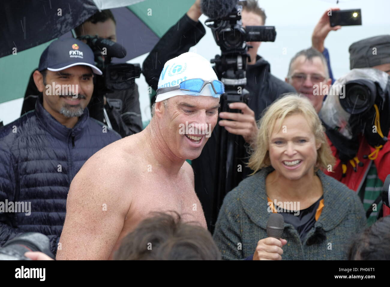 Dover, Kent, UK. 29th August 2018. Lewis Pugh completes his grueling 'Long Swim'  challenge by swimming from Lands End to Dover (330 miles) meaning he will swim 5 hours every day for 50 days. Lewis Pugh talking to the media having completed the swim. Photo Credit Paul Lawrenson /Alamy Live News - Stock Image
