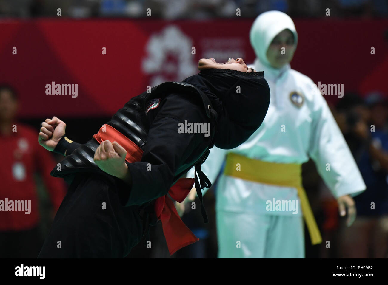 Jakarta, Indonesia. 29th Aug, 2018. Pipiet Kamelia of Indonesia celebrates after the Pencak Silat Men's 60kg to 65kg gold medal match agaisnt Nguyen Thi Cam Nhi of Vietnam at the 18th Asian Games in Jakarta, Indonesia, Aug. 29, 2018. Credit: Pan Yulong/Xinhua/Alamy Live News - Stock Image