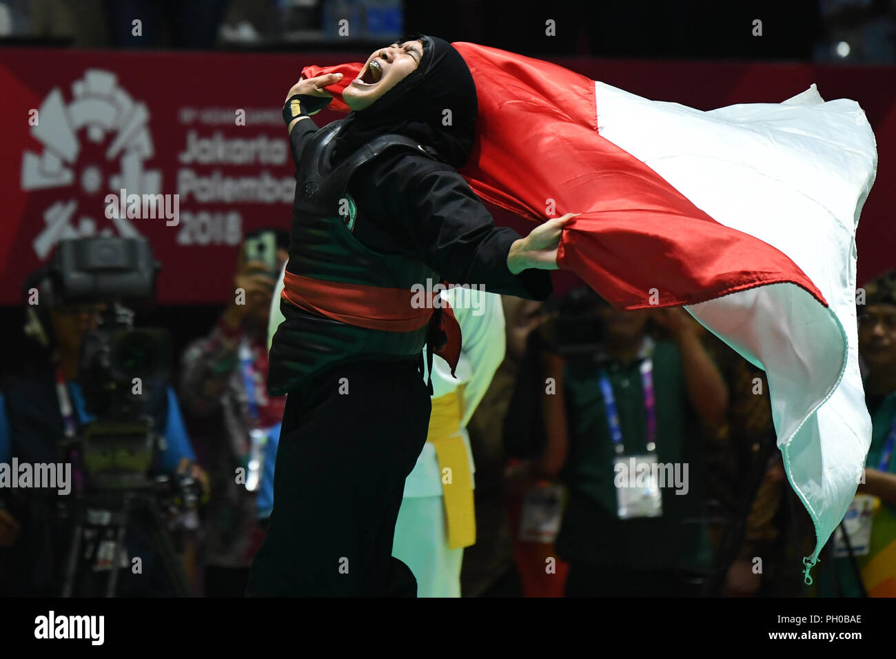 Jakarta, Indonesia. 29th Aug, 2018. Pipiet Kamelia of Indonesia celebrates after the Pencak Silat Women's 60kg to 65kg gold medal match agaisnt Nguyen Thi Cam Nhi of Vietnam at the 18th Asian Games in Jakarta, Indonesia, Aug. 29, 2018. Credit: Pan Yulong/Xinhua/Alamy Live News - Stock Image