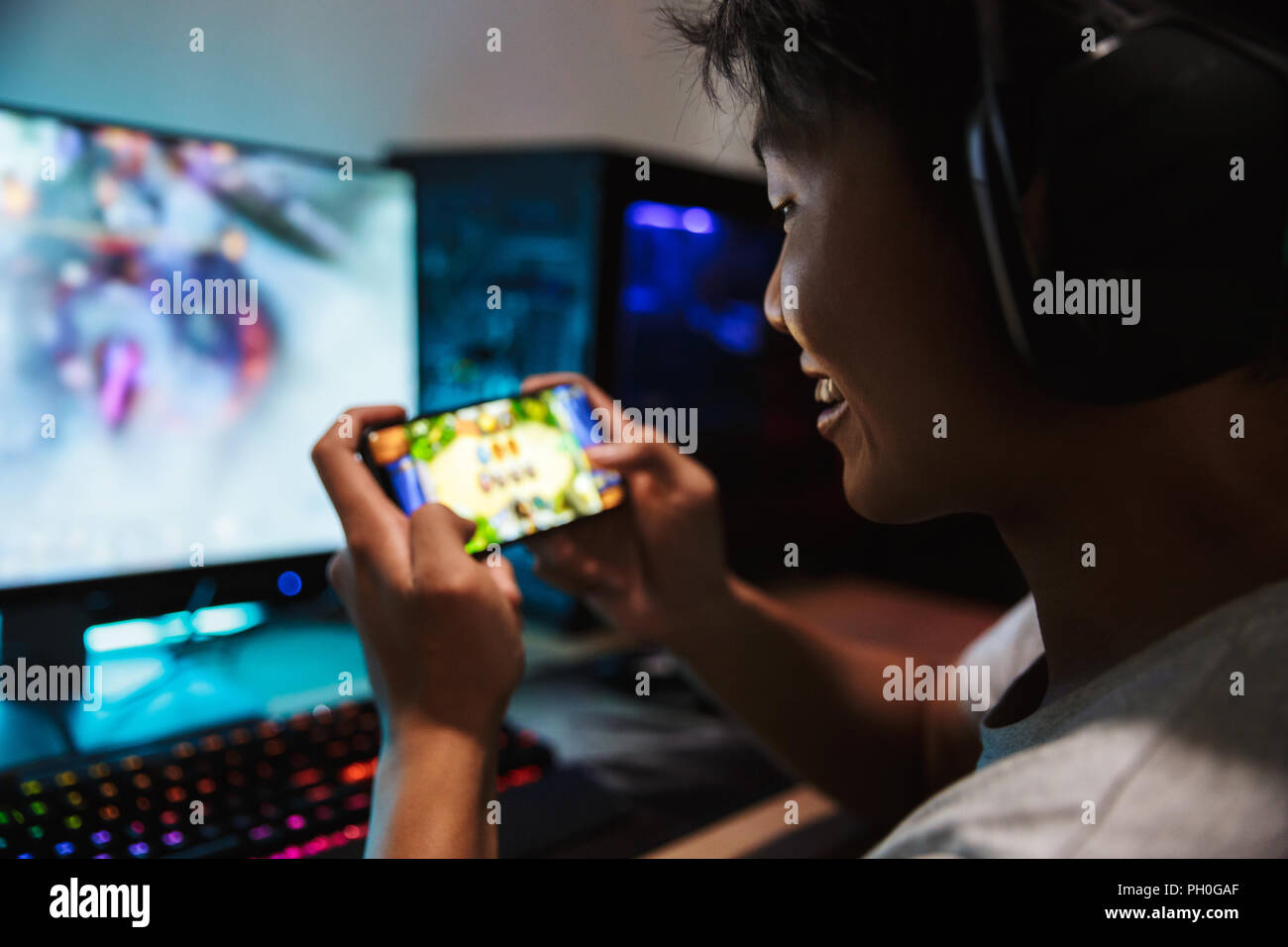 Photo of joyous gamer boy playing video games on mobile