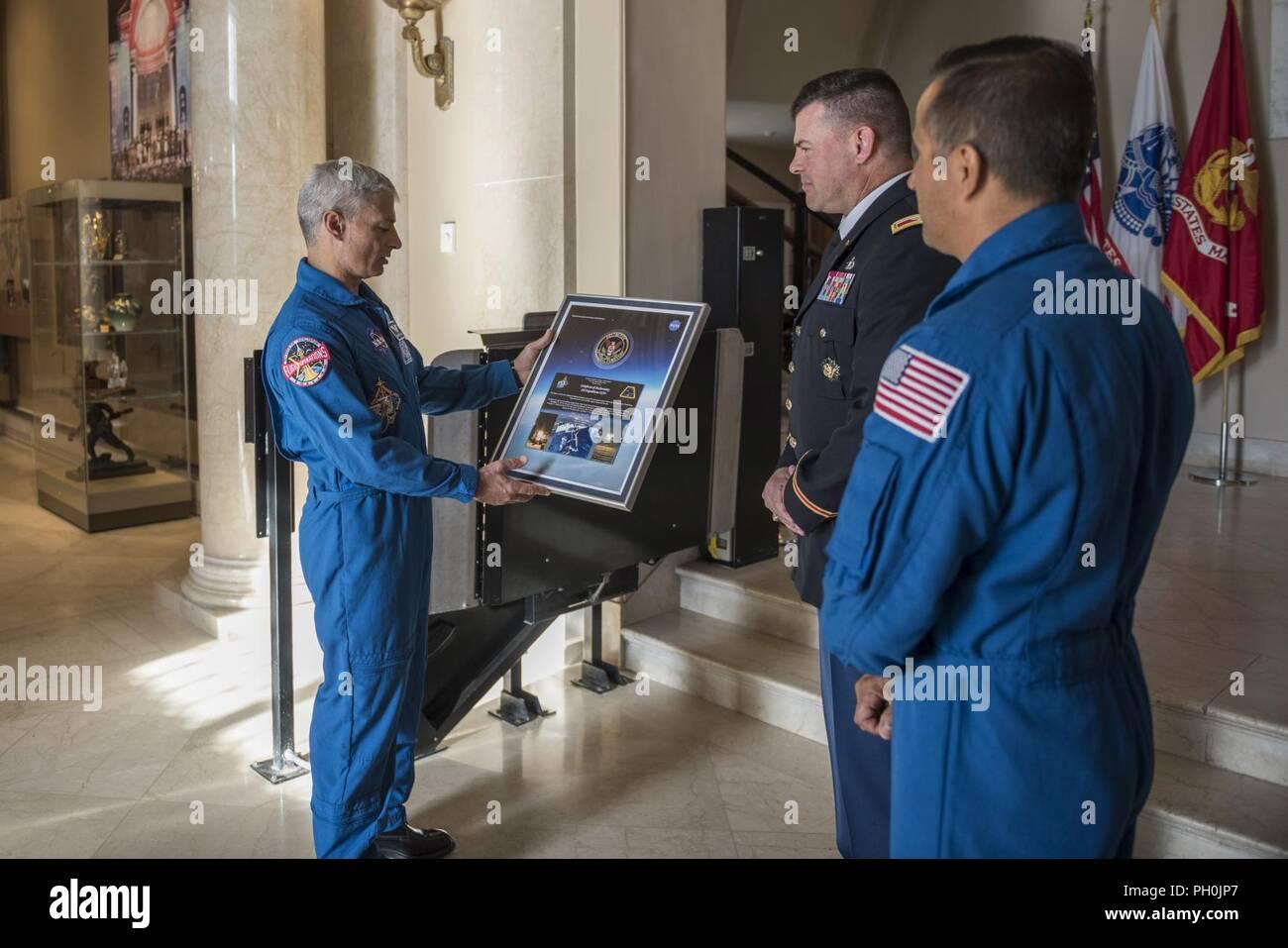 NASA astronauts Mark Vande Hei (center) and Joe Acaba (right